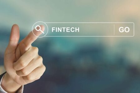 Stock image of hand pointing to the word Fintech in a search bar