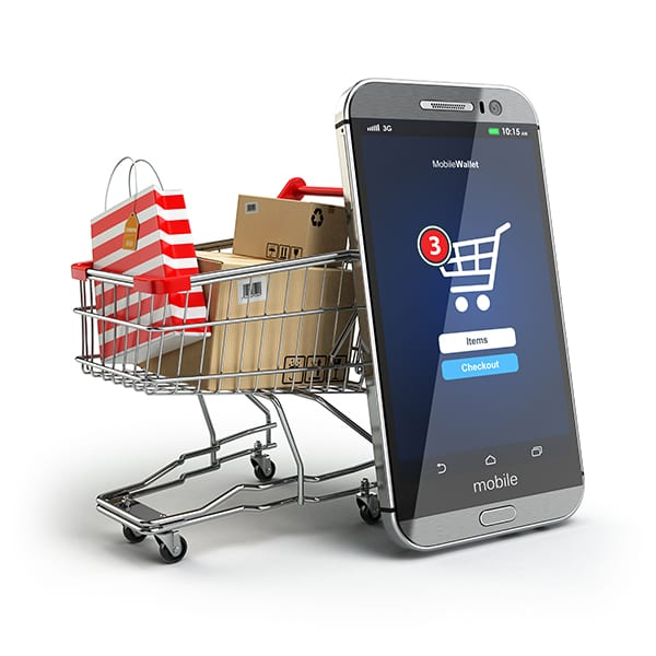 Stock image of shopping card with mobile phone
